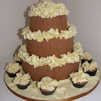 Three Tier Chocolate With Ruffles And Matching Fairycakes