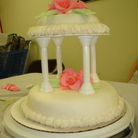 Wilton Course 3 Class 4 ~ Tiered Wedding Cake My first tiered cake. Tulips and roses (which aren't visible in this photo) are made from fondant. The cake was buttered pecan with...