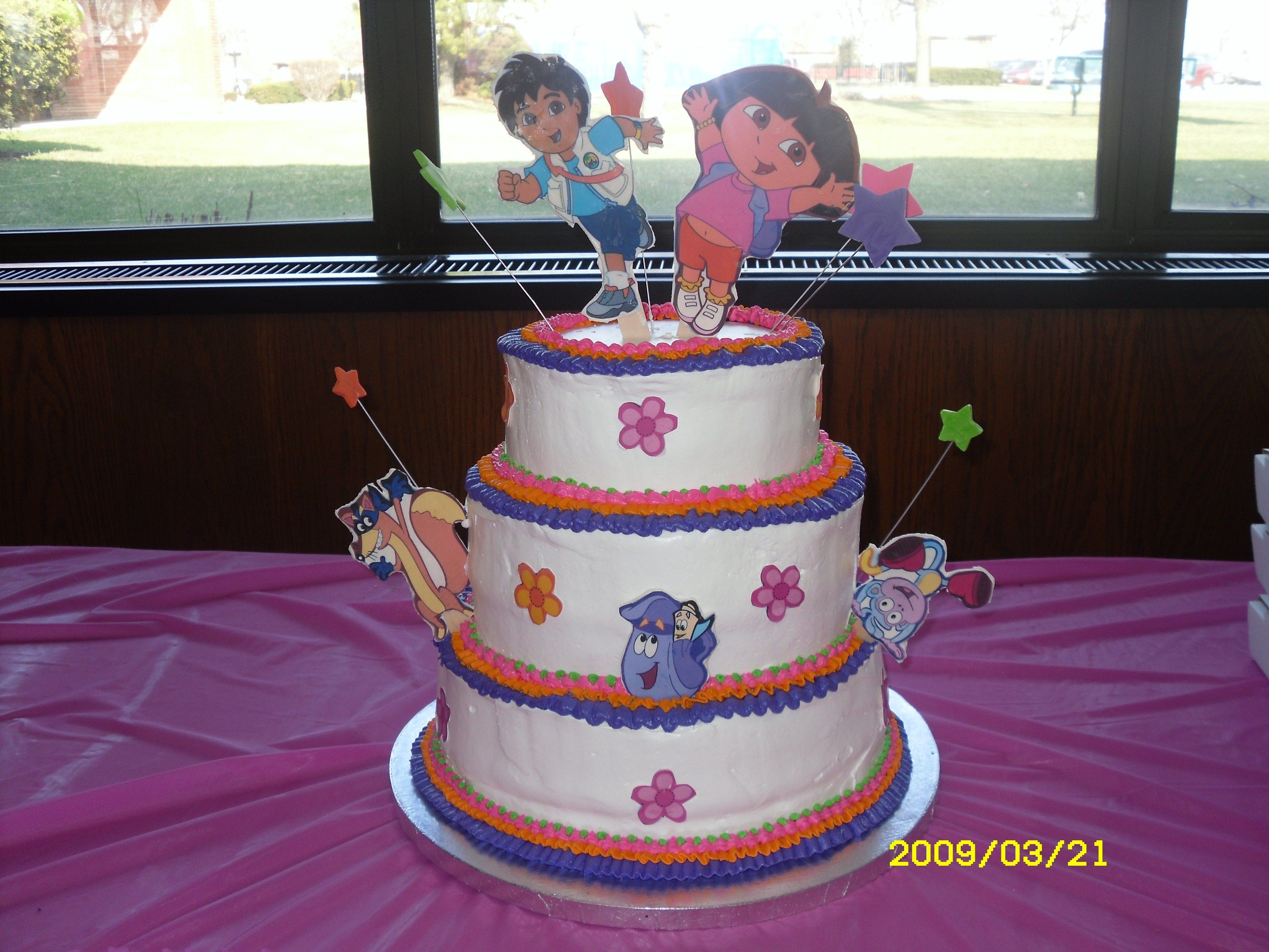 Dora & Diego  Birthday cake for my 3 daughters. Edible image plate of Dora, Diego and Friends. I was not happy with the uneven bottoms, I couldn't...