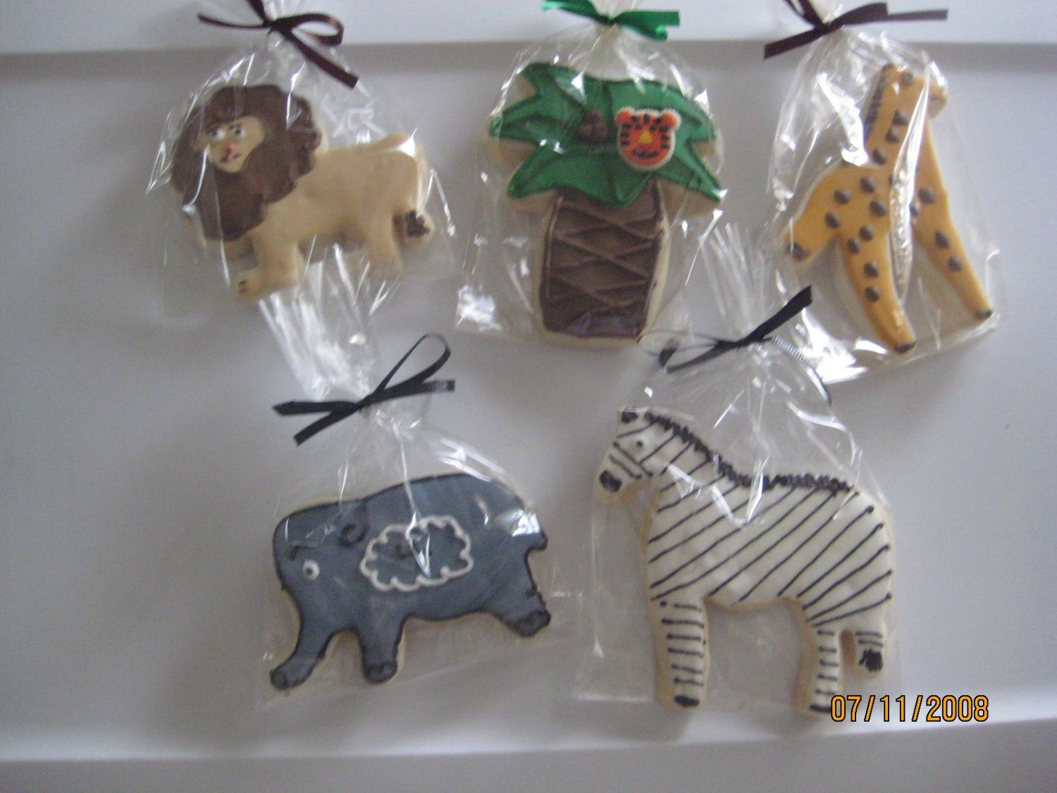 Jungle Cookies  NFSC with Antonias RI Jungle cookies i made for my twin's birthday party favors. I foundout that is is hard to make spots on the...