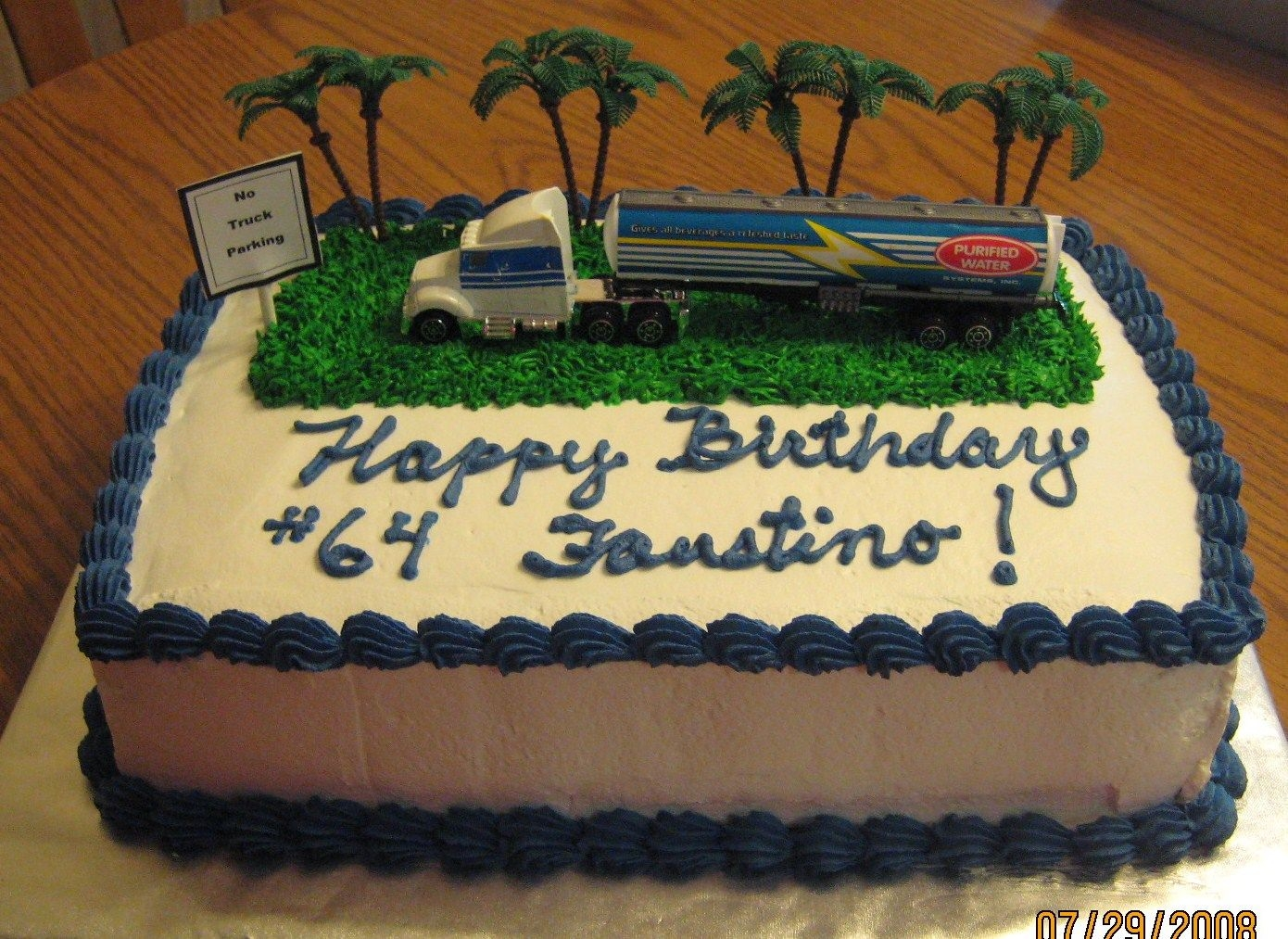 "Truck Driver Birthday Cake  11x 7 cake. I made this cake for my Dad's Birthday. He is a truck driver who always likes to park histruck ""anywhere"",......"
