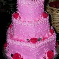 Pink Hexagon Weddingcake Three tier Hexagon shape with strawberry flavored cake and fresh fruit strawberry filling