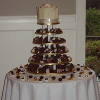 Wedding Cupcake Tower Choc dipped strawberries and choc truffles with a cutting cake on top.