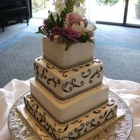 Square Wedding Cake All bc icing,silver ribbon and real flowers.
