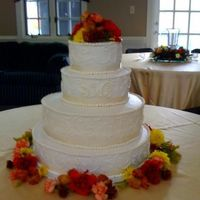 Ivory Wedding Cake   All BC icing with real flowers and ribbon