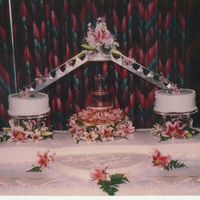 Fountain And Lillies This cake was for 400 people. Trimmed in pearls and iced in b/c. I did this one several years ago, but have done others in the same design...