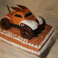 Monster Mutt  1/2 sheet cake on bottom with brown sugar dirt. Monster Mutt vehicle was yellow cake with chocolate donut wheels, fondant tail, ears, and...