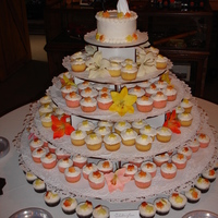 Fall Cupcake Wedding Cake Fall wedding for 200 people. Flavors were strawberry with french vanilla icing, yellow with orange icing and gluten-free chocolate with...