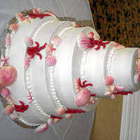 Seashell Wedding Cake Two tiers of this cake were almond buttermilk with almond icing and the other two were yellow cake with orange flavored icing. The...