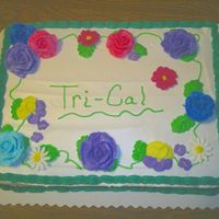 Flowers I made this cake for my Dad to take to his work for a potluck. This was basically a practice cake.