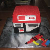 Pressure Washer I did this cake for a little boy who loved pressure washers, generators and tools. I was modeling it after the toy one that he has....