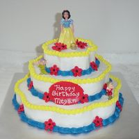 Snow White Strawberry and yellow cake. Iced in Buttercream , fondant flowers.