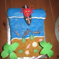 Surfing Crab On The Beach I made this cake for my daughters 6th birthday. She wanted a beach them and then we made candy surf boards for favors and she decided to...