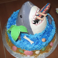 Shark Cake This was for my son's 6th birthday and he helped design it. The shark head was made out of rice krispie treats covered in fondant and...