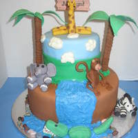 Zoo Cake This was a cake for a party at the Zoo. All the animals are made out of fondant.