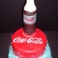 Diet Cocoa-Cola Flavored with Diet Coke chocolate cake with Red Satin Ice and fondant water droplets. the bottle is cocoa Krispie treats covered with...