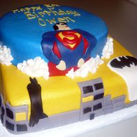 Superman Batman Cake This cake is a double layer cake with colored butter cream icing. The decorations are made out of homemade marshmallow fondant. Created for...