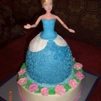 "Cinderella Cake This is my first doll cake. It was more work than I expected, but was a good learning experience. 10"" chocolate, 6"" yellow,..."