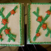 Poinsettas  Lemon cake with lemon bc filling and icing as requested by customer. BC poinsettas and pine swag added b/c it was for an office Christmas...