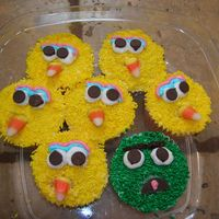 Big Bird, Oscar, Elmo, Cookie Monster Cupcakes - Sesame Street All frosted then dipped into same color sprinkles. Eyes are mini chocolate chips upside down. I used a candy corn for Bird's beak!...