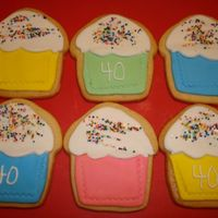 Cupcake Shape Birthday Cookies NFSC for a 40th Birthday with Rolled fondant, RI and non-pariels. I used my fondant cutter/roller for the impression of the cupcake paper,...