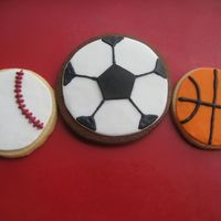 Sports Balls, Baseball, Soccer Ball, Basket Ball Cookies NFSC with rolled satin ice fondant and RI decoration details. I printed a pentagon template and cut the soccer ball center shape by hand...