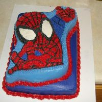 Spiderman  This cake was done in the new spiderman pan, but my dh and I thought that it was too small and so we layered it onto a 1/4 sheet cake....