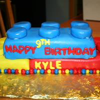Lego Cake   Another lego cake... marble cake with buttercream and fondant. I cut a sheet cake into 3 to make this...
