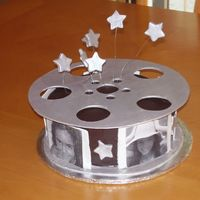 "Movie Themed Cake Chocolate cake with chocolate buttercream. I used the birthday girl's pictures as the ""movie"" strips.Thanks to CC'er..."