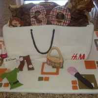 30Th Birthday Cake  This was for my cousin who's totally into fashion and her favorite store is H&M. She loved it. All the accents done in fondant and...