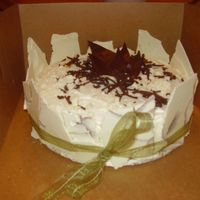 013_-_Copy.jpg White cake soaked in Godiva white chocolate liquor with dulce de leche filling, covered in white chocolate shards, tied with green ribbon...
