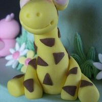Happy Giraffe gumpaste giraffe for a baby cake. Thanks to the cake central users for the inspiration!