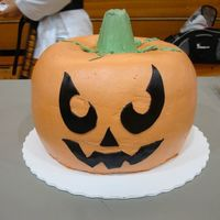Scary Jack O'latern Wanted to try this cake since I saw quite a few version here on CC. The cake was a chocolate pumpkin spice baked in 2 bundts. Filled with a...