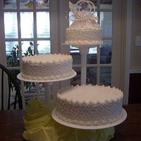 Cornelly Lace 3-Tier Wedding Cake   3-TIER, WITH LARGE PEARLS AND SMALL AROUNG THE BASES. TOPS, HAVE SMALLER PEARLS ALSO..... BRIDE LOVED THIS CAKE, MATCHED HER TOPPER...