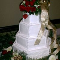 Christmas Wedding Cake This cake was white cake with lemon or raspberry filling and was a Christmas wedding. Monogram was made from royal icing.