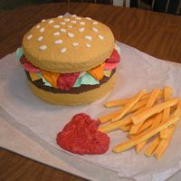 Hamburger And Fries Cake I made this cake for my niece's birthday party Hamburger white cake (bun) and chocolate cake (burger). I piped dots of chocolate icing...