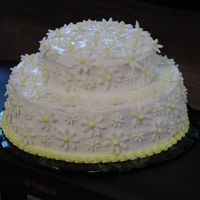 Daisy Cake white buttercream icing with sugar paste daisies with royal icing centers.
