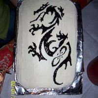 Dragon Cake This cake is red velvet with a cream cheese frosting. The dragon is an exact copy of the birthday girls tattoo. I took the tattoo print and...