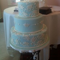 Wedding Cake For Bridal Show Fondant covered cake with tulip cutouts using the Patchwork cutters.