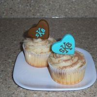 Bridal Shower Cupcakes Tiramisu cupcakes with marscapone buttercream and fondant hearts.Recipe for marscapone buttercream: 12 tablespoons unsalted butter, room...