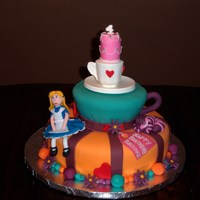 Mad Hatter Tea Party Cake Fondant and chocolate clay decorations. Teacup on top is made of chocolate.