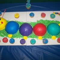 Baby Einstein Caterpillar I used the sports ball pan for the cakes, dowel rods covered with icing for the antennaes and green coconut for the grass. The cakes are...