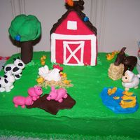 Barnyard Birthday Cake This cake was made for my daughter's 2nd birthday. Everything on the cake is edible. The tree and barn are made from rice krispie...