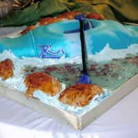 Kayak  The kayak is the only cake, the rocks in the water is chocolate rocks & i used color flow for the waves & piping gel for the clear...