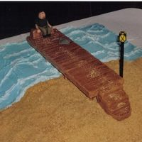 Sitting On The Dock Of The Bay  the waves i made with color flow & the sand is graham crackers. i made the pier with styrofoam & covered it in fondant. The cake it...