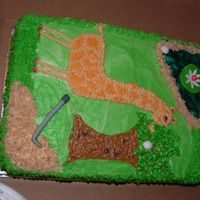 Golfing Giraffe A friend asked me to do a cake for her daughter, who likes giraffes and her husband, who likes golf. She loved the outcome.