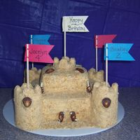 Sand Castle Cake This was a birthday cake for my two children as well as myself. The cake is made of 2 16x16 and 2 8x8 in a french vanilla mix, & 15...