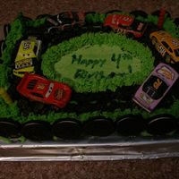 Racetrack  My four year old son wanted cars, cars, and more cars for his birthday cake. The racetrack is made of crushed Oreos and the frosting is...