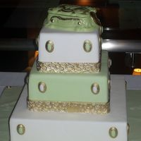 100_2355.jpg This cake was entered as my first time entry into a cake show. Covered in fondant with a chocolate keepsake box as a topper