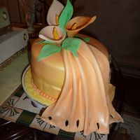 Light Orange Calla Lily Cake This cake is covered in a light orange fondant topped with calla lilys